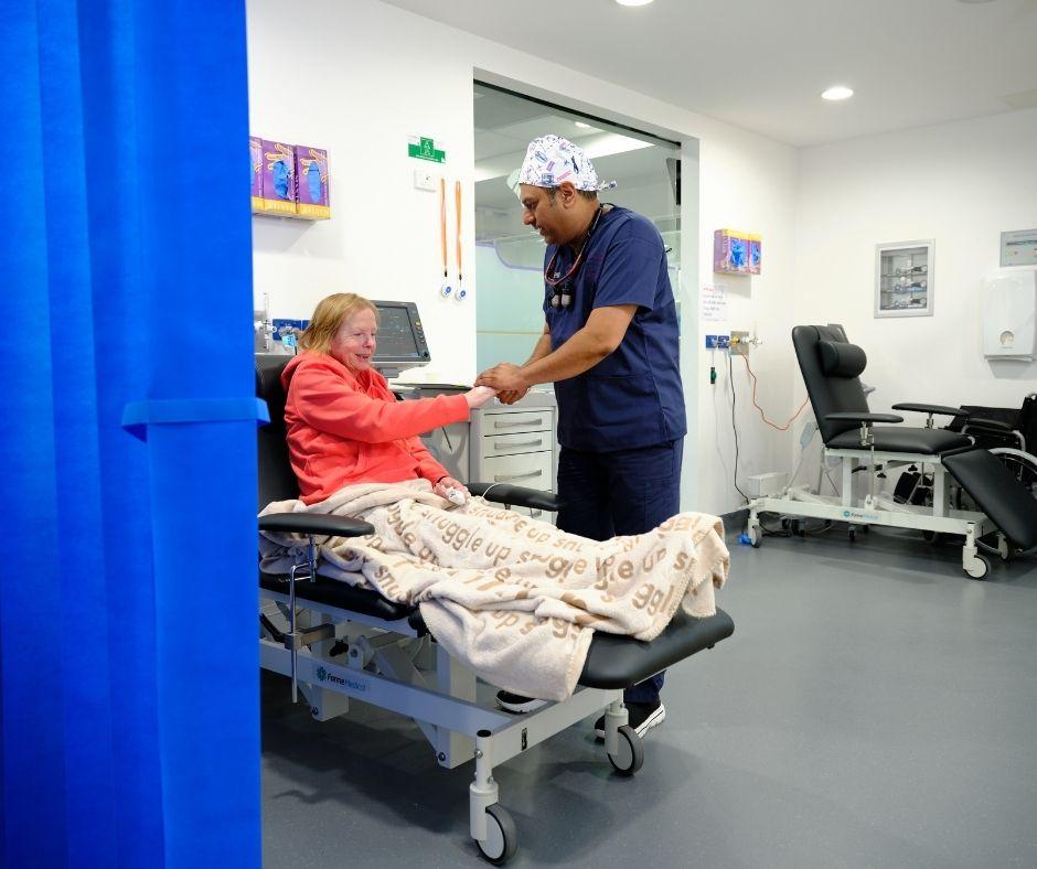Dentist looking after an elderly patientf-finesse dentist Melbourne